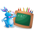 A bunny in front of a chalkboard with pencils at vector image