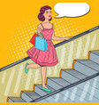 pop art woman with shopping bags on escalator vector image