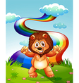 A happy lion at the hilltop with a rainbow in the vector image