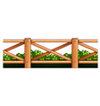 Wooden fence and bush vector image