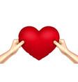 heart pillow in hands realistic vector image
