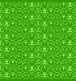 the floral patterns on a green background vector image