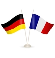 Table stand with flags of Germany and France vector image