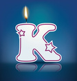 Candle letter K with flame vector image