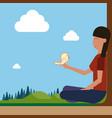 girl sitting on groud outdoors hold bird on hand vector image