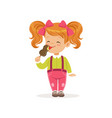 cheerful little child licking delicious chocolate vector image