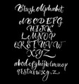 black background with white scrawling alphabet vector image