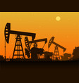 Silhouettes of oil pumps vector image