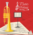 trumpet instrument with music sheets vector image
