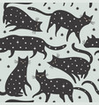 seamless pattern black cats with stars vector image