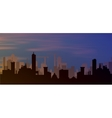 silhouette of town with sunset and clouds in sky vector image