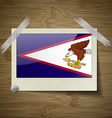 Flags American Samoa at frame on wooden texture vector image