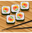 sushi on bamboo mat vector image