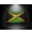waving flag jamaica on a dark wall vector image