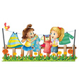 Two girls drying their clothes vector image