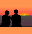 silhouettes of young lovers on the beach vector image