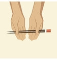 hand with chopsticks vector image