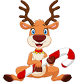 Cartoon funny baby bear holding Christmas candy vector image