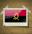 Flags Angola at frame on a brick background vector image