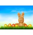 Holiday Easter background with straw rabbit and vector image vector image