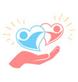 hand holds two loving hearts vector image