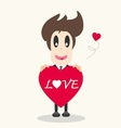Businessman holding a red heart vector image