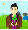 Man holding plant vector image