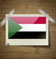 Flags Sudan at frame on wooden texture vector image