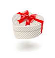 Beige gift box with red bow vector image