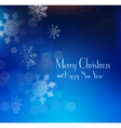 blue Christmas background with snowflakes blurred vector image