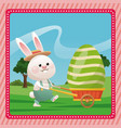 happy easter bunny carrying egg pink frame vector image