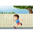 A little boy running at the road vector image vector image