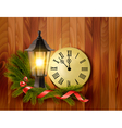 Christmas background with a lantern and a clock vector image