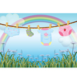 Hanging baby clothes under the rainbow vector image