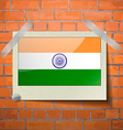 Flags India scotch taped to a red brick wall vector image