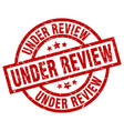 under review round red grunge stamp vector image