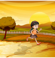 A girl running along the field vector image vector image