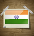 Flags India at frame on wooden texture vector image