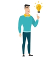 Businessman pointing at business idea light bulb vector image