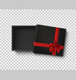 opened black empty gift box with red ribbon vector image