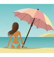 Woman on the beach under umbrella vector image