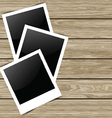 blank photos on wood background 0704 vector image