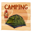 Camping equipments with lantern and tent vector image