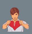 handsome man holding broken heart tearing red vector image