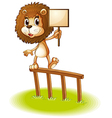 A lion standing on a wooden fence holding an empty vector image vector image