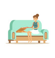 beautiful girl sitting on a light blue sofa and vector image