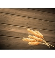 Wheat on wooden background EPS 10 vector image