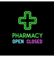 Pharmacy neon sign on black background vector image