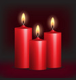 Three red burning candles on black background vector image vector image