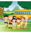 Children standing by the schoolbus vector image